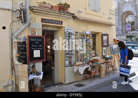 La Maison Jaune Brocante Tourist shop in front of the Roman Amphitheatre Arles France - Stock Photo