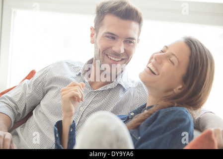 Couple spending lighthearted time together at home - Stock Photo