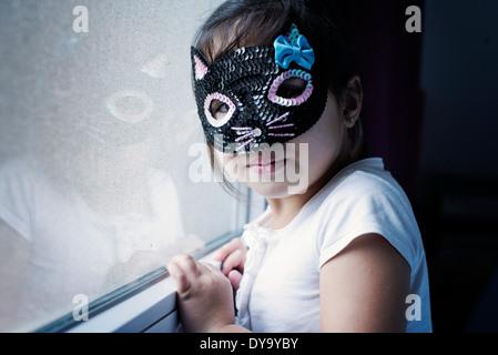 Little girl wearing mask - Stock Photo