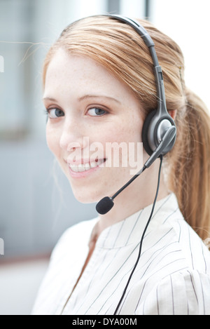Telemarketer at work - Stock Photo