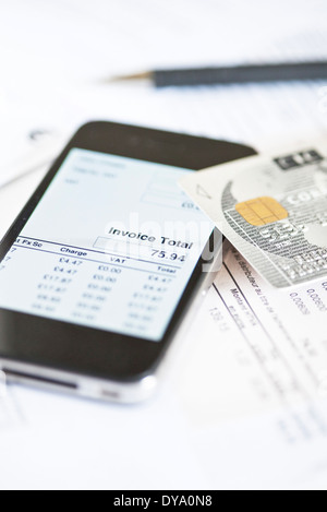 Smartphone being used for online banking - Stock Photo