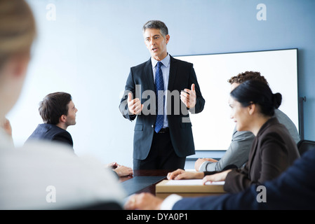 Corporate trainer leading training session - Stock Photo