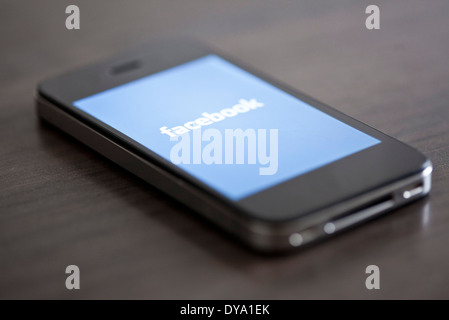Close-up of smartphone displaying social media app - Stock Photo