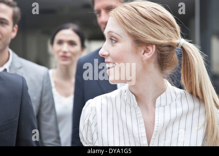 Businesswoman looking at associate - Stock Photo