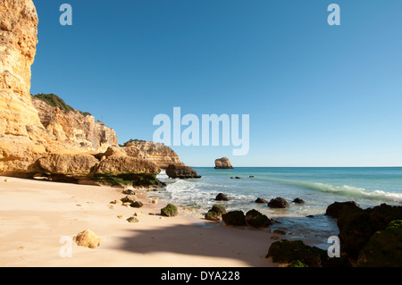 sandstone cliffs at Praia da Marinha beach in the Algarve Portugal - Stock Photo