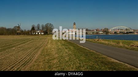 Netherlands Holland Europe Deventer Overijssel landscape field meadow water winter bridge Bolwerks windmill Ijssel - Stock Photo
