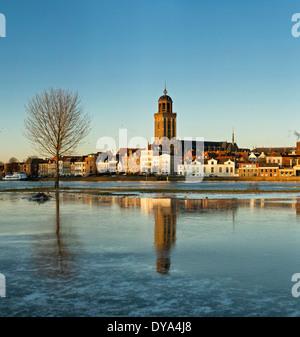 Netherlands Holland Europe Deventer Overijssel city village water winter snow ice reflections Lebuinus church frozen - Stock Photo