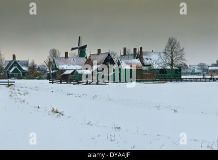 Netherlands Holland Europe Zaandam North Holland city village field meadow winter snow ice windmills Open-air museum - Stock Photo