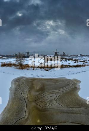 Netherlands Holland Europe Zaandam North Holland windmill field meadow winter snow ice Open-air museum Zaanse Schans - Stock Photo