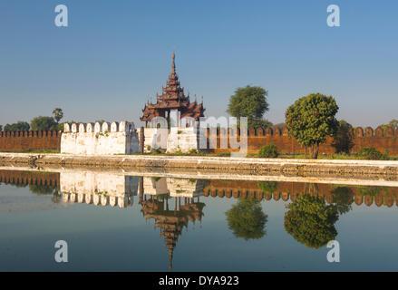 Mandalay Royal Palace Myanmar Burma Asia architecture city colourful history moat reflection skyline touristic travel - Stock Photo