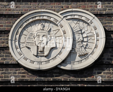London, England, UK. Detail on wall of the Saville Theatre - Egyptian / Assyrian art (Gilbert Bayes) - Stock Photo