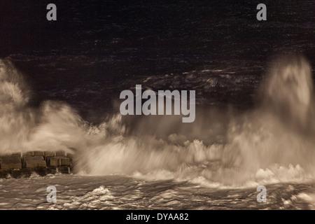 Storm waves hitting coastline by night - Stock Photo