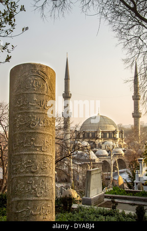 Historical Ottoman Headstone With Engravings And Eyup Sultan Mosque At Eyup, Istanbul - Stock Photo