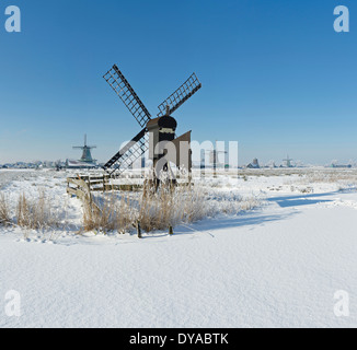 Netherlands, Holland, Europe, Zaandam, North Holland, windmill, field, meadow, winter, snow, ice, Windmills - Stock Photo