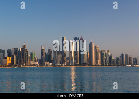 Doha Qatar Middle East West bay architecture bay calm city colourful economy futuristic impressive morning new skyline - Stock Photo