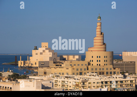 Doha Qatar Middle East architecture center city Islamic minaret mosque museum old skyline symbol touristic tower - Stock Photo