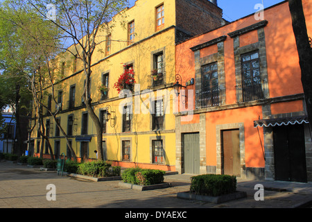 Yellow and orange buildings in the centre of Mexico City, Mexico - Stock Photo