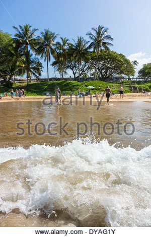 Surf coming on to Kamaole Beach at Kihei on the island of Maui in the State of Hawaii USA - Stock Photo