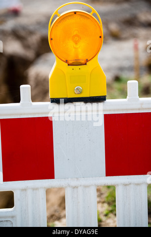 yellow signal lamp on construction site - Stock Photo