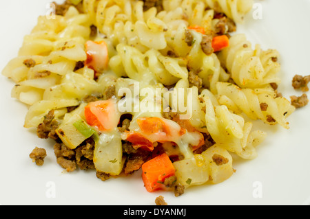 Pasta with tomatoes, meat and cheese on a plate closeup. - Stock Photo