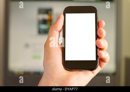 Closeup of Man's Hand holding a Smartphone in Office - Stock Photo