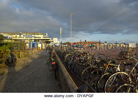 Bicycles in a bike rack near the ferry terminal on Norderney Island in East Friesland, Lower Saxony, Germany. - Stock Photo