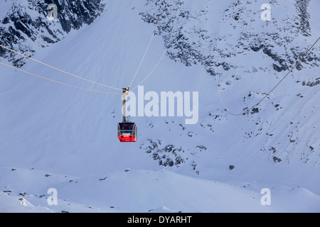 The Aiguille Du Midi gondola, carries passengers to the top of Aiguille Du Midi mountain above Chamonix Mont-Blanc, - Stock Photo
