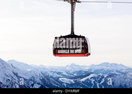 The Aiguille Du Midi gondola, carries passengers to the top of Aiguille Du Midi mountain above Chamonix Mont-Blanc, - Stock Photo
