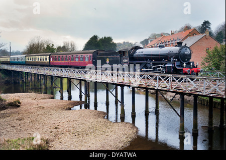 Thompson B1 steam locomotive from the NYMR railway crosses the bridge over the River Esk at Ruswarp on way to the - Stock Photo