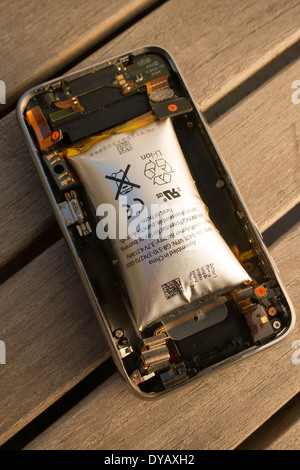 Modern cellphone having suffered from damage due to Lithium Ion battery swelling - Stock Photo