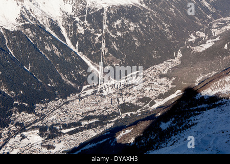 The village of Chamonix Mont-Blanc seen from a lookout point at the Aiguille Du Midi (3842m) mountain top. - Stock Photo