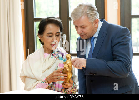 Berlin, Germany. 12th Apr, 2014. The Burmese Nobel Peace Prize Laureate Aung San Suu Kyi receives a golden bear - Stock Photo