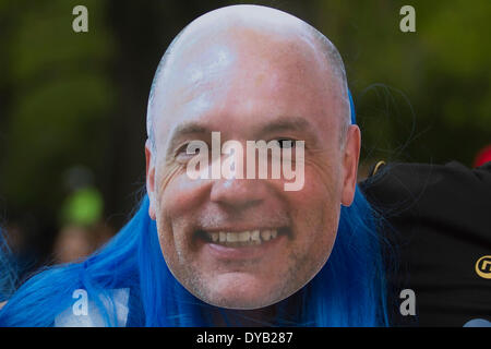 Wembley London, UK. 12th April 2014. A  Wigan  Football supporter wearing a mask of manager Uwe Rossler  as Wembley - Stock Photo