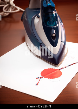 Metaphorical view of changes and modifications in legal agreements, presented with an iron and certified contract. - Stock Photo
