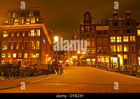 Streetview from Amsterdam in the Netherlands at night - Stock Photo