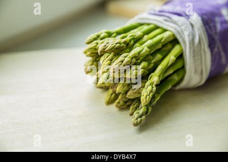 Asparagus bundled in a cloth - Stock Photo