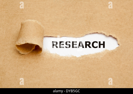 The word Research appearing behind torn brown paper. - Stock Photo