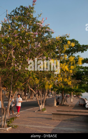 Strollers along the Mekong riverfront boulevard in Kratie, Cambodia - Stock Photo