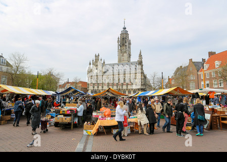Antique market in front of the famous Town Hall of the city of Middelburg, capital of Zeeland province, the Netherlands. - Stock Photo