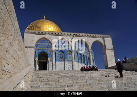 Muslim girls in front of Dome of the Rock Mosque, Temple Mount, Old city of Jerusalem, Israel - Stock Photo