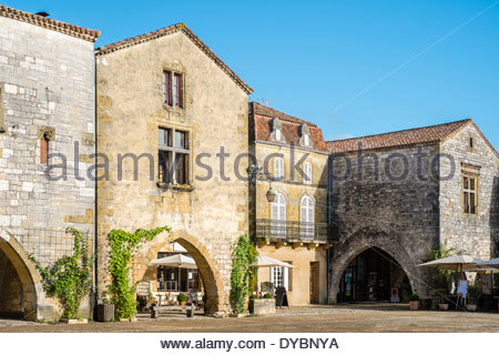La place des Cornières town square of French bastide town of Monpazier, Dordogne department, Aquitaine, France - Stock Photo