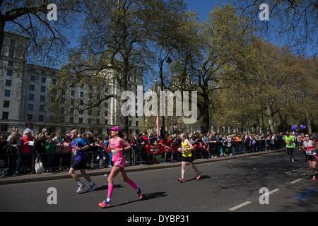 London, UK. 13th Apr, 2014. Competitors running in the main public event of the Virgin Money London Marathon 2014. - Stock Photo