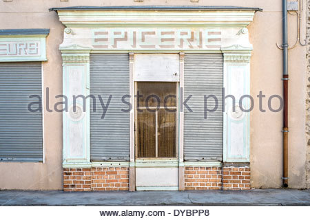 Storefront of empty shop with antique painted Epicerie (Grocer's) sign, Homps, Aude Department, Languedoc-Roussillon, - Stock Photo