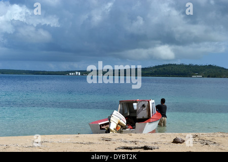 Boat docked in a beach in Nukutapu islet, Wallis Island, Wallis and Futuna, Melanesia, South Pacific - Stock Photo