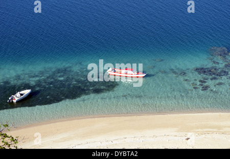 Boats docked in a beach in Nukutapu islet, Wallis Island, Wallis and Futuna, Melanesia, South Pacific - Stock Photo