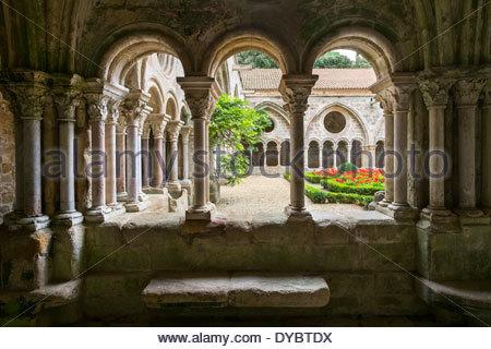 Romanesque cloisters at Abbaye de Fontfroide, Aude Department, Languedoc-Roussillon, France - Stock Photo