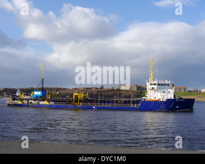 UKD Marlin, a trailing suction hopper dredger, leaving the River Tyne, South Shields, England, UK - Stock Photo