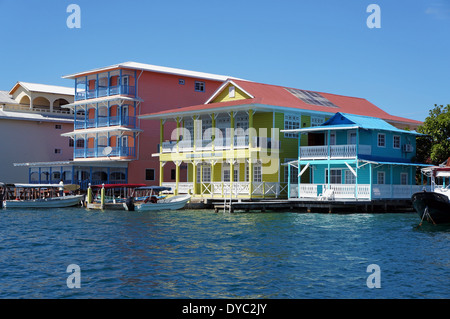 Colorful Caribbean houses over water with boats at dock, Colon island, Bocas del Toro, Panama - Stock Photo