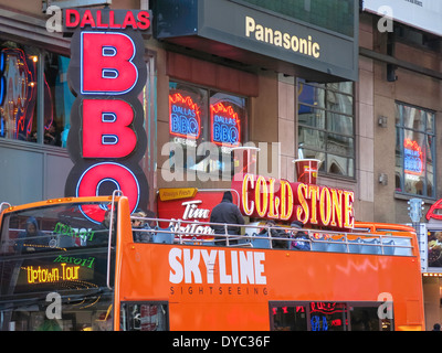 Signs and Bus on W. 42nd Street, Times Square, NYC - Stock Photo