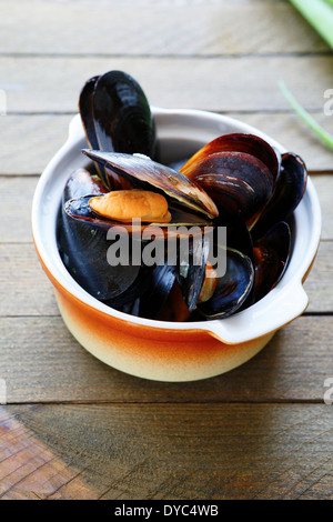 mussels steamed in a sauce, food closeup - Stock Photo